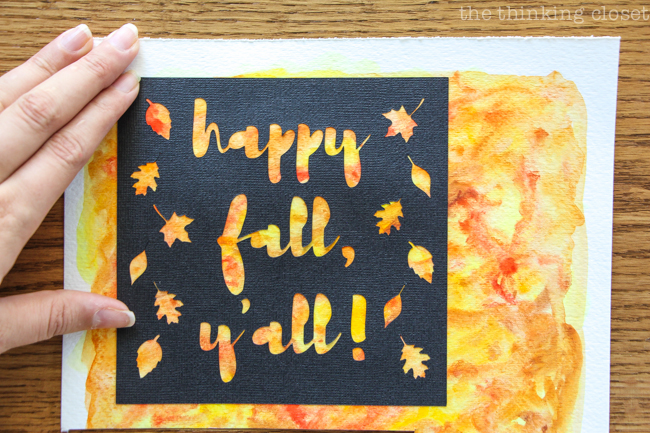"""Happy Fall, Y'all!"" Watercolor Art: A Silhouette Cameo 3 Tutorial - After peeling up my adhesive backed cardstock, I applied it to my watercolor background for a vibrant, autumnal finished piece!"