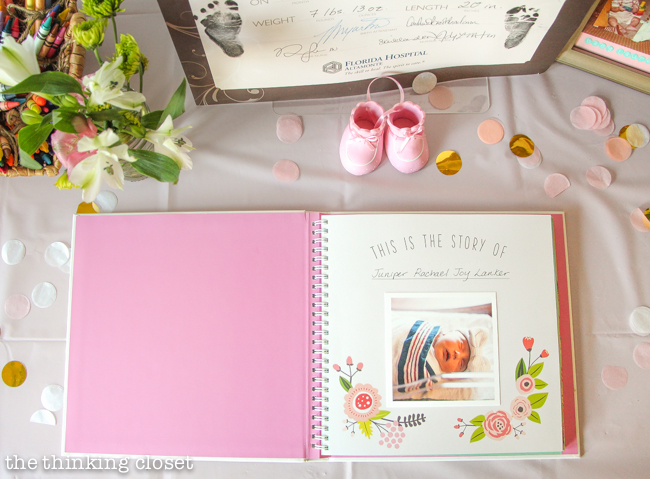 Baby Book on display at a Blooming First Birthday Bash, inspired by spring flowers in pink, blush, and white. DIY party ideas for a woodland floral-themed celebration, spring fling, or botanical garden party!