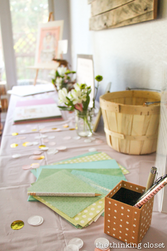 Time Capsule Station at a Blooming First Birthday Bash, inspired by spring flowers in pink, blush, and white. DIY party ideas for a woodland floral-themed celebration, spring fling, or botanical garden party!