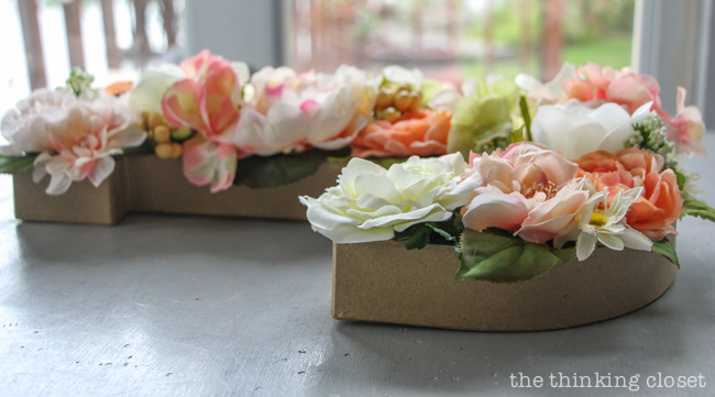 DIY Floral Monogram Letter for a Blooming First Birthday Bash, inspired by spring flowers in pink, blush, and white. Such a fun DIY party idea for a woodland floral-themed celebration, spring fling, or botanical garden party! Love the timelapse video!